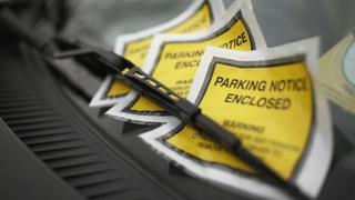 parking ticket on windscreen