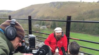 Brian Blessed talks to the media in the Peak District