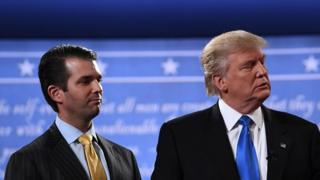 Donald Trump Jr. stands onstage with his father Donald Trump after presidential debate in Hempstead, New York on 26 September 2016