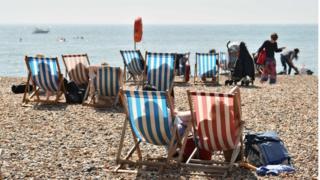 Beachgoers in Brighton, UK