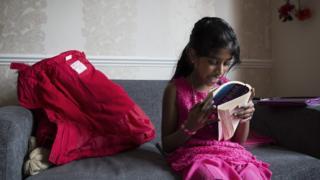 Sri Lankan girl reading Roald Dahl