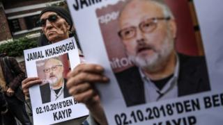 """Protesters holding portraits of missing journalist and Riyadh critic Jamal Khashoggi with the caption: """"Jamal Khashoggi is missing since October 2"""" during a demonstration in front of the Saudi Arabian consulate in Istanbul on 9 October"""