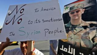 Supporters of President Bashar al-Assad protests against new US sanctions in Umayyad Square, Damascus (11 June 2020)