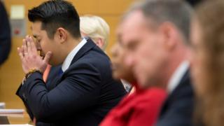 Police officer Peter Liang reacts as the verdict is read during his trial on charges in the shooting death of Akai Gurley