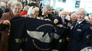 Former WASP pilots hold a banner during a Congressional Gold Medal ceremony at the US Capitol on March 10, 2010 in Washington, DC. The ceremony was held to honour the Women Air Force Service Pilots (WASP) of WWII. The WASP was a pioneering organization of civilian female pilots employed to fly military aircrafts under the direction of the United States Army Air Forces during World War II