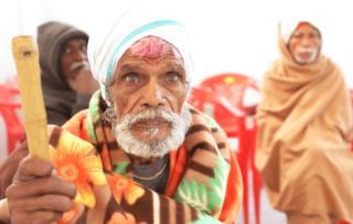 An old man lost at the Kumbh Mela