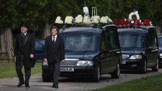 A hearse carrying the coffin of Leslie Rhodes, who died in the Westminster attack