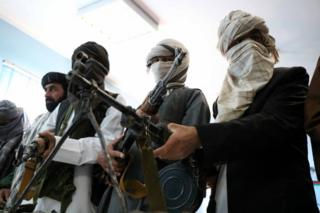 Former Taliban members surrender their weapons during a reconciliation ceremony in Herat, Afghanistan, 21 February 2018.