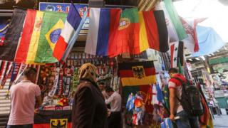 A shop in the old city of Damascus selling flags of the World Cup finals teams