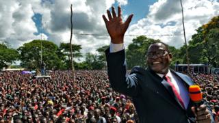 Opposition Malawi Congress Party leader Lazarus Chakwera addresses supporters after a court annulled the May 2019 presidential vote in Lilongwe