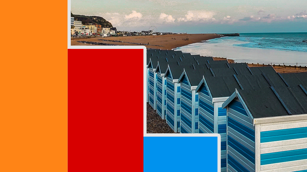 A bar chart over a picture of Hastings beach
