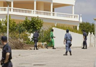 in_pictures Portuguese police helped by dogs search for Madelaine McCann in front of the Ocean club apartment hotel in Praia de Luz in Lagos on 4 May 2007