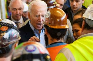 in_pictures Democratic presidential candidate Joe Biden has a heated exchange with a worker as he tours the Fiat Chrysler plant in Detroit, Michigan on 10 March 2020