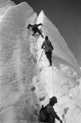 George Mallory leads climbers up a sheer wall of snow and ice