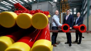 Darren McGavigan of Fabplus is pictured with Alastair Hamilton and Des Gartland, Invest NI.