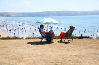 The heatwave continues, and holiday makers flock to the coast of North Devon.