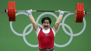 Kuk Hyang Kim (PRK) of North Korea competes in weightlifting at the Rio Olympics