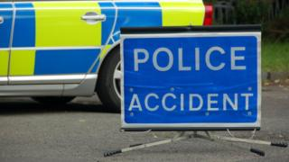Police accident sign and vehicle
