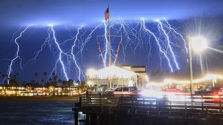 Extraordinary photo shows 10 lightning forks striking over a Santa Barbara wharf