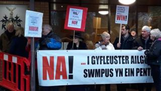 Abermule villagers protest outside Powys County Hall in Llandrindod Wells in January 2019