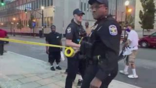Police are shown in social media clips from the scene of the shooting