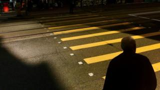 Man crossing road in China