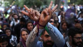 Supporter of Iranian President Hassan Rouhani flashes victory sign to celebrate victory. Tehran, May 20, 2017