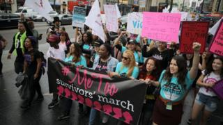 People participate in a protest march for survivors of sexual assault and their supporters on Hollywood Boulevard in Hollywood, Los Angeles, California U.S. November 12, 2017.