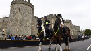 Police on horse back outside Windsor Castle in Windsor