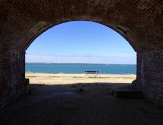 Ocean view through an archway