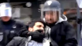 A mobile phone grab shows a man identified as Alexandre Benalla dragging away a demonstrator on 1 May 2018