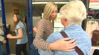 Donna Jones hugging a customer
