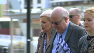 John Briers entering court
