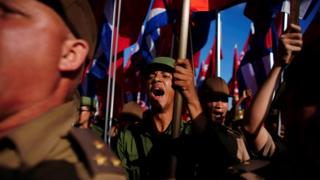 Cuban soldiers shout slogans during a May Day rally