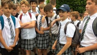 Boys kitted out in summer skirts