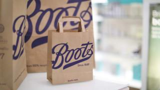 Boots paper bags in a shop