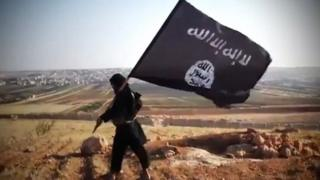 A file image grab taken from a video uploaded on YouTube on 23 August 2013 shows a member of the so-called Islamic State