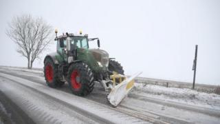A snow plough clears a road in Shaftesbury, Dorset.