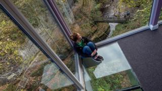 Woman sat on glass floor