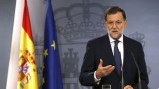 Spanish Prime Minister Mariano Rajoy talks to media during a press conference in Madrid