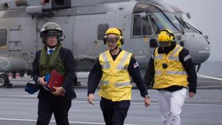 Sir Michael Fallon getting off a helicopter