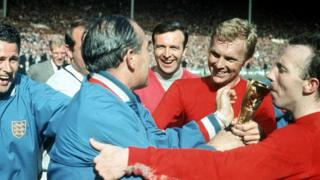 Alf Ramsey, Bobby Moore, Nobby Stiles and others celebrate after England are presented with the trophy