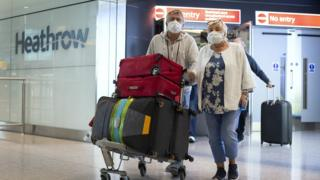 science Passengers from the Holland America Line ship Zaandam walk through arrivals in Terminal 2 at Heathrow Airport in London, after flying back on a repatriation flight from Florida.