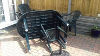 Overturned garden furniture