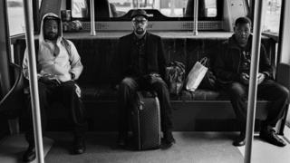 Wu-Tang Clan members in an airport shuttle bus