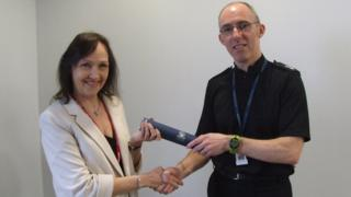 Sandra MacLean receiving her award from Ch Supt George Macdonald