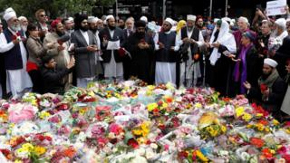 Faith groups stand by the flowers left at London Bridge