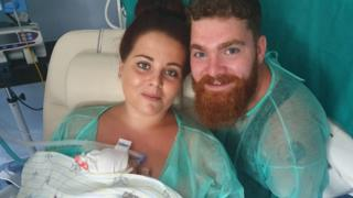 Shannon Holbrook and Matthew Beach with their baby Scarlett-Rose