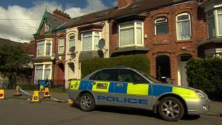 Police car outside property