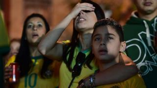 Fans can't look during Brazil's loss to Germany at the 2014 World Cup